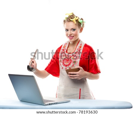 Woman is cooking with the recipe on a laptop over white background