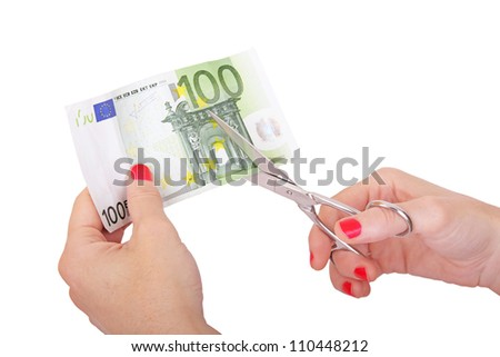 woman is cutting banknote with scissors