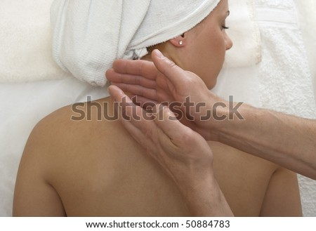 Woman is getting back massage from a physiotherapist.