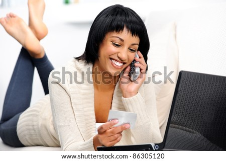 Woman is happy she can shop online and confirm her reservations over the phone