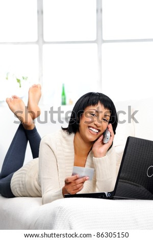 Woman is happy to be connected remotely to her bank details via phone and the internet