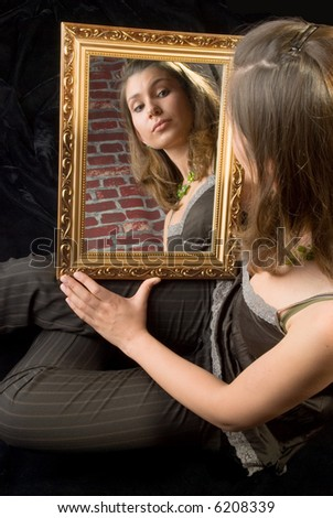 Woman Is Holding A Mirror In Her Hand Stock Photo 6208339