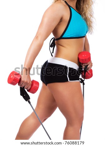 woman is holding dumbbells and skipping rope