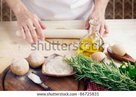 Woman is kneading dough balls.