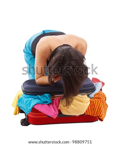 woman is not sure how to make things fit in her suitcase