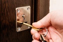 Woman is opening the door using keys