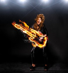 woman is playing rock music on fiery guitar