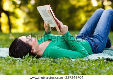 Woman is reading a book and enjoys in her free time,Leisure time