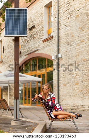 Woman is reading book sitting under solar power plant #153193463