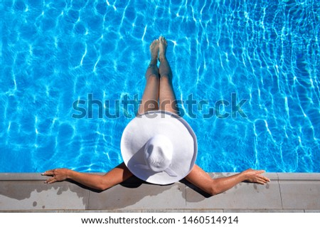 Woman is relaxing in the pool