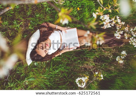 Shutterstock Woman is resting in hammock in cherry garden