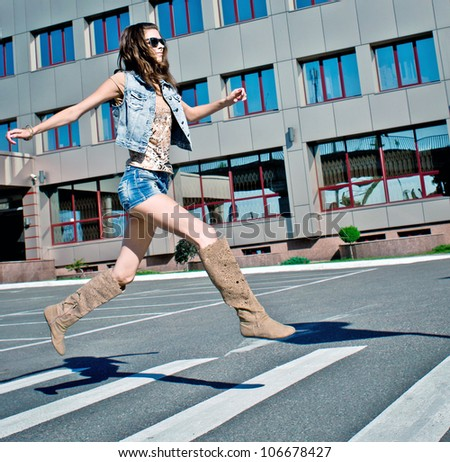 Woman is running down street