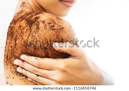 Woman is scrubbing body with coffee. Foto stock ©