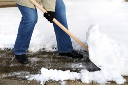 Woman is shovelling snow
