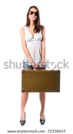 woman is standing with old leather case - stock photo