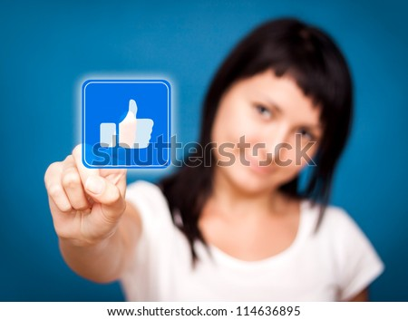 Woman is touching the like button - Social Media.