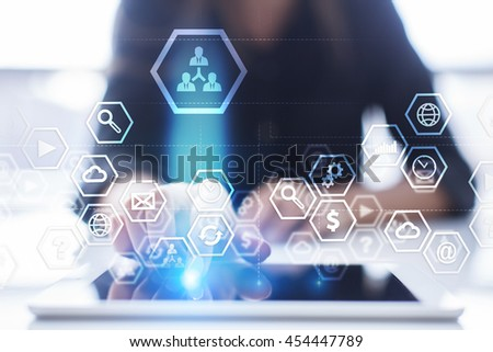 Woman is using modern tablet pc, presssing on touch screen and select concept. #454447789