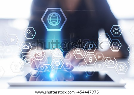 Woman is using modern tablet pc, presssing on touch screen and select concept. #454447975
