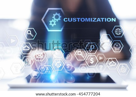 Woman is using tablet pc, pressing on virtual screen and select 'Customization'. ストックフォト ©