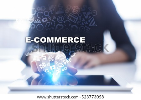 Woman is using tablet pc, pressing on virtual screen and selecting e-commerce.