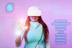 Woman is using vr headset to access for personal data. Concept of using future technology for cybersecurity, protection personal data.