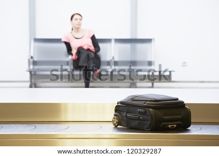 Woman is waiting at the airport.