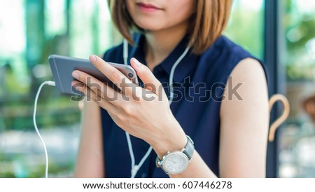 Woman is watching a video on her mobile