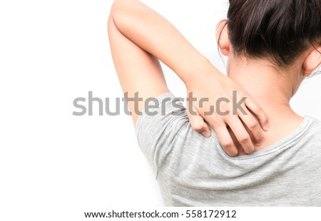 Woman Itching on shoulder with white background for healthy concept
