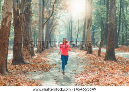 Woman Jogging. Nature, Outdoor Park #1454653649