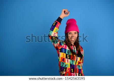 woman joyful young cheerful joy on blue background fashion style #1542563195
