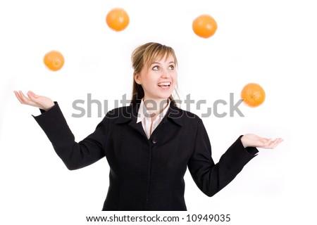 Woman juggling with oranges / multitasking