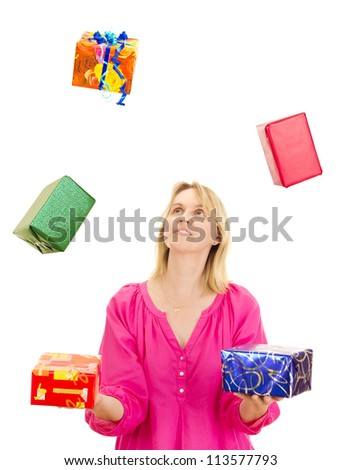 Woman juggling with some colorful gifts