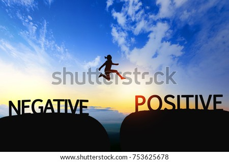 Woman jump through the gap between Negative to Positive on sunset.