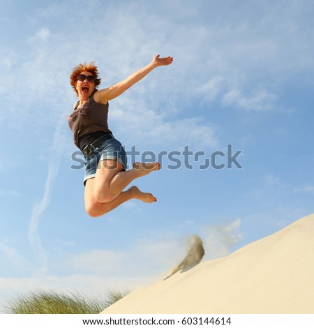 woman jumping for joy/jumping for joy/ woman jumping for joy #603144614