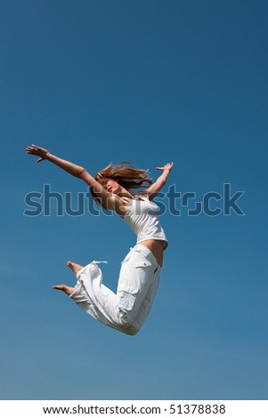 Woman jumping in the sky