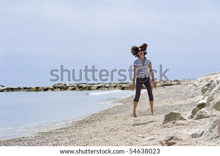 Woman jumping on the beach.