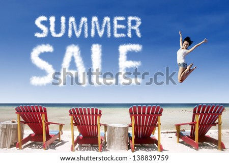 Woman jumping over beach chairs with summer sale cloud