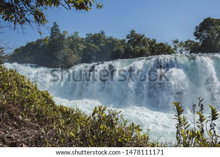 Woman jumping waterfall in indigenous village #1478111171