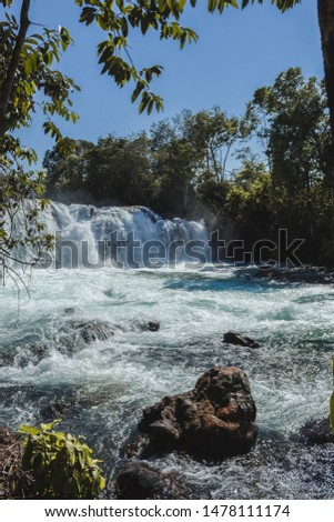 Woman jumping waterfall in indigenous village #1478111174