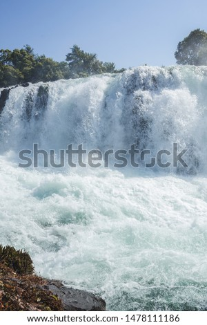 Woman jumping waterfall in indigenous village #1478111186