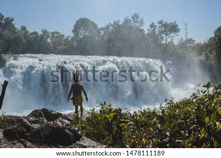 Woman jumping waterfall in indigenous village #1478111189