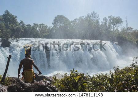 Woman jumping waterfall in indigenous village #1478111198