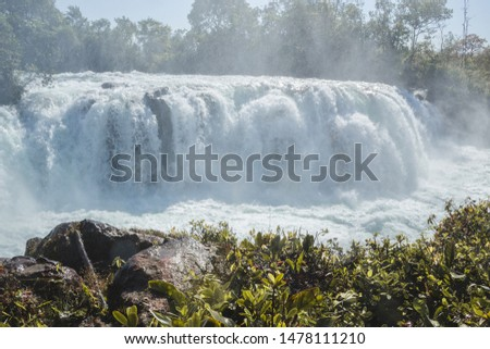 Woman jumping waterfall in indigenous village #1478111210
