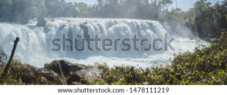 Woman jumping waterfall in indigenous village #1478111219