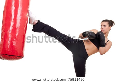 Woman Kick boxer with red punching bag- isolated on white
