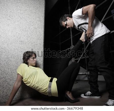 Woman kicking the man in self defense