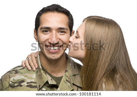 Woman Kisses Latino Serviceman on the Cheek