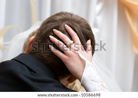 woman kisses the man and embra?e his head with her hand