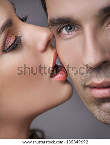 Woman kissing her man