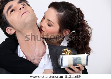 Woman kissing her partner for a present